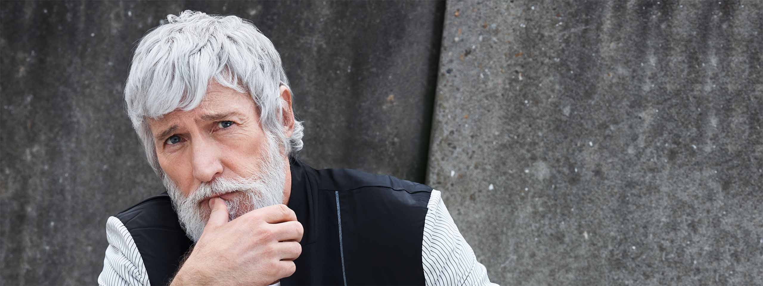 Model Aiden with grey hair and beard.